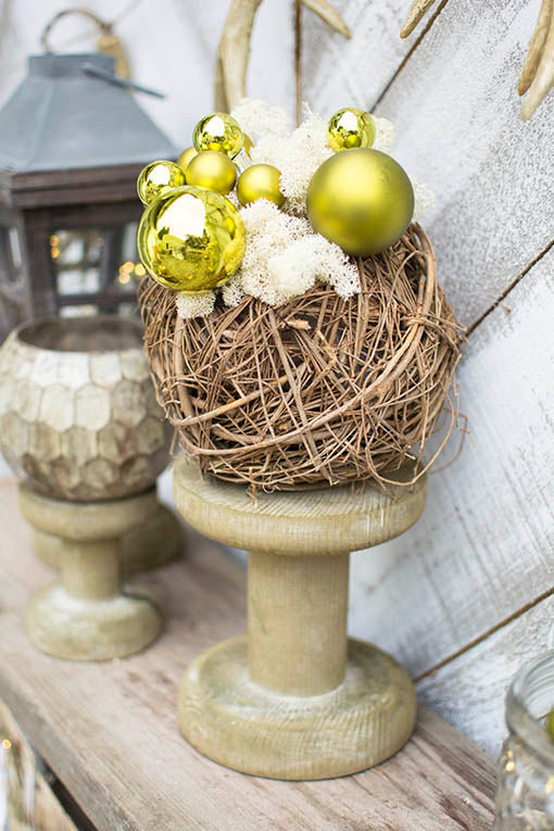 Display this natural wood vase on a spool pedestal with green floral picks and our white moss as woodland holiday decor.