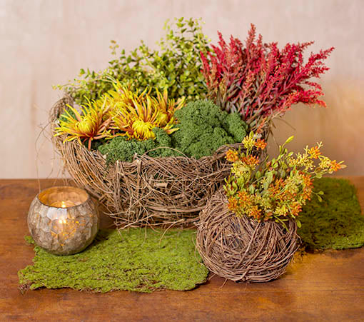 Embrace the natural look of this basket by adding wild flowers and decorative moss. Accent this centerpiece with our mercury glass candle holders.