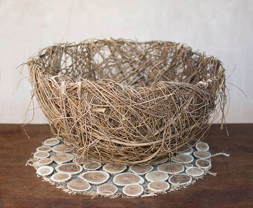 Each basket is made with elm twigs that perfectly complement our other natural wood decor.