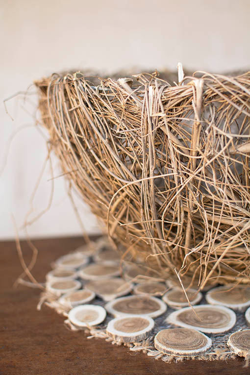 Elm twigs wrap around a wire frame to easily support items placed in this basket.