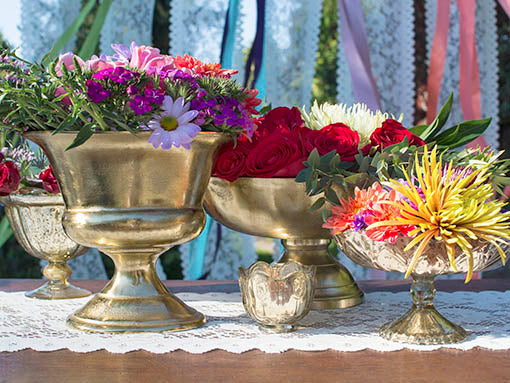 Blend this stately vase with other gold tone decor, including metallics and mercury glass, for a spectacular table top.