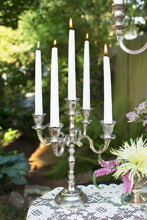 Whether for an elegant woodland affair, or a classic gala event, our silver tone candelabra set the right tone. Taper candles sold separately.