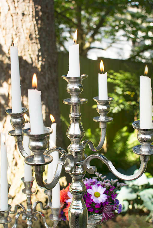 Replace the 7-inch floral platter with the included taper holder to establish a classic candelabra configuration. All taper candles are sold separately.