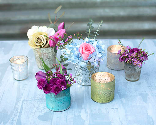 These uniquely textural glass votive candle holders combine beautifully with our full range of mercury glass decor.