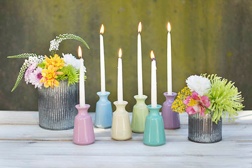 Use your choice of fine grain filler to stabilize your miniature taper candles for a darling table display! Pair with rustic accessories for charming color play.