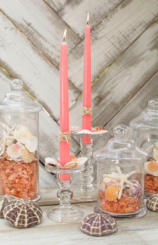 Refresh your table with a coastal chic centerpiece of coral taper candles, clear glass candle holders and our cylinder jars.