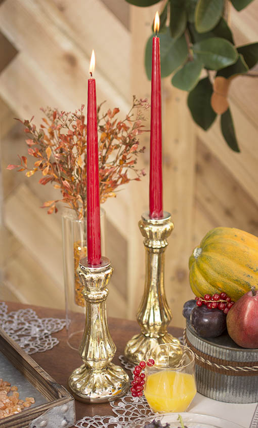 Inspire industrial chic decor in your home or event by adding gold mercury glass candle holders, lace table runners, and corrugated vases to your pomegranate red taper candles.