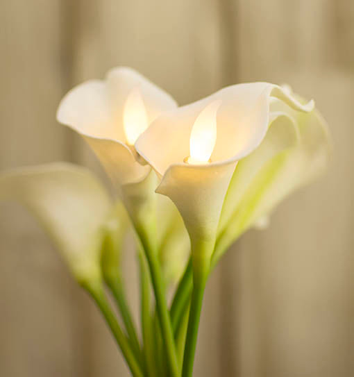 Create a bouquet full of brilliance by adding the candle flames to artificial flowers.