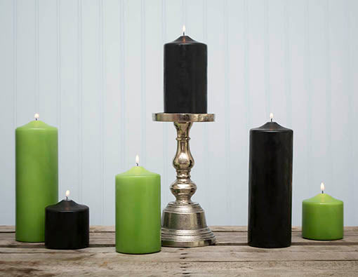 Add our fresh green pillar candles and silver candle holders for a Halloween chic look!