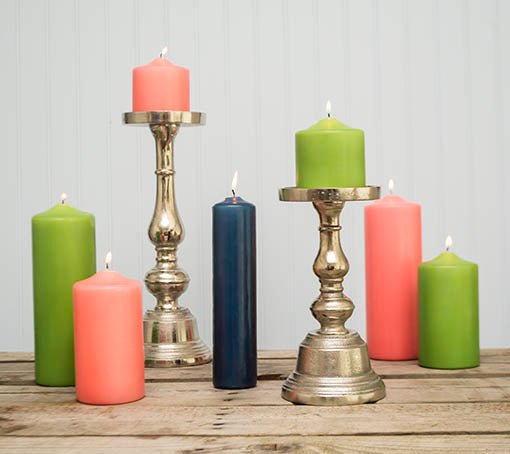 Arrange a bright and fun Christmas display with our fresh green, coral pink, and navy blue candles alongside our candle holders!