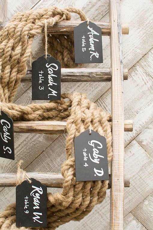 Stylishly display name cards for your nautical wedding with our woven table runner weaving between the steps on our wooden ladder!