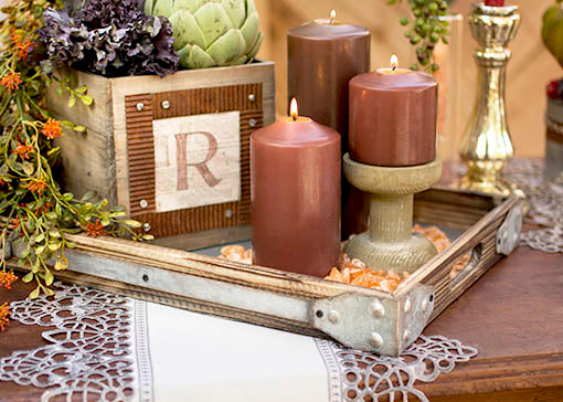 Create a rustic inspired centerpiece for your wedding by pairing our serving trays with our table runner, chocolate brown candles and planter boxes with metal ribbon accents