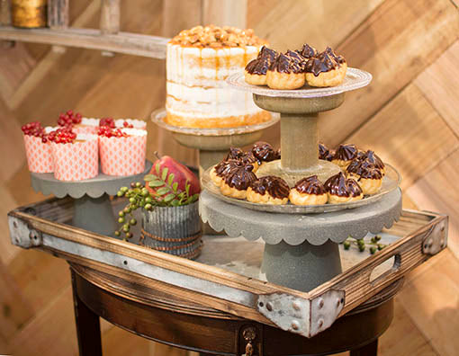 Inspire industrial chic elegance with our metal cake stands, corrugated vases and embossed glass plates as a centerpiece on this serving tray!