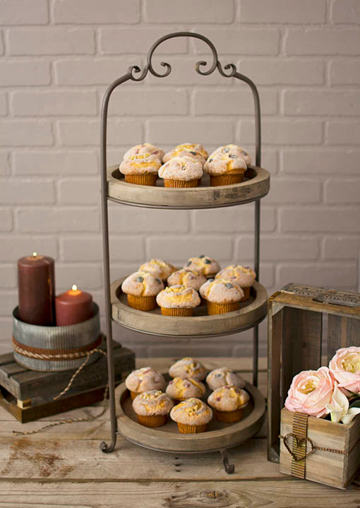 Add rustic accents to your event by surrounding our three tiered serving tray with candles, yardstick trays and planter boxes embellished with metal ribbon.