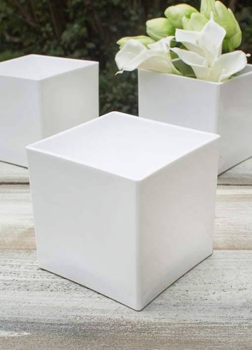 Each square vase is made from a white durable plastic that complements any theme or design.