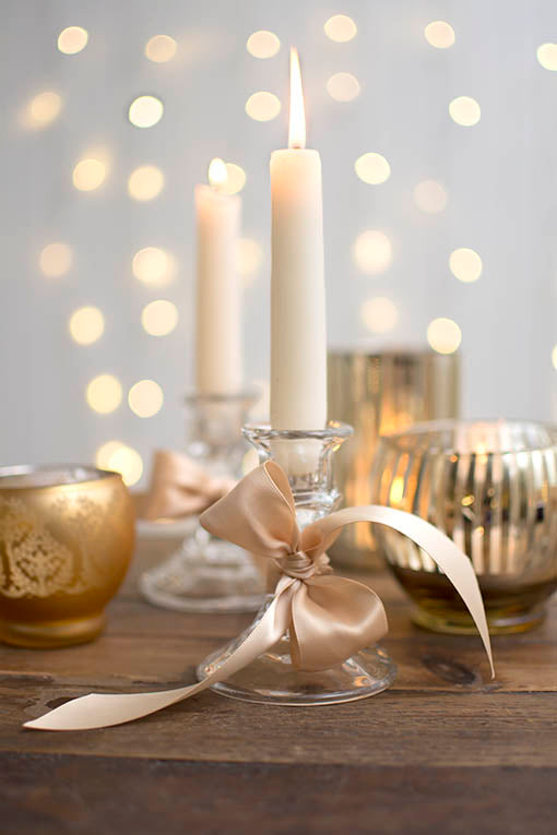Coordinate our clear glass taper candle holders to a wide variety of mercury glass table decor with the simple addition of ribbon! All items sold separately.