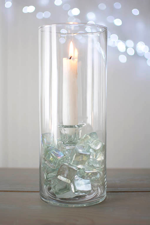 Tucked within a tall glass vase and surrounded with eye-catching vase filler, these 4 inch tall taper holders will secure your candles in a unique display.