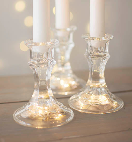 Conceal a popular strand of fairy moon lights beneath each candlestick ... the small battery pack fits perfectly!