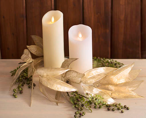 Nested within a wreath formed of our superior quality faux foliage, Luminara candles offer the picture of elegance. All items sold separately.