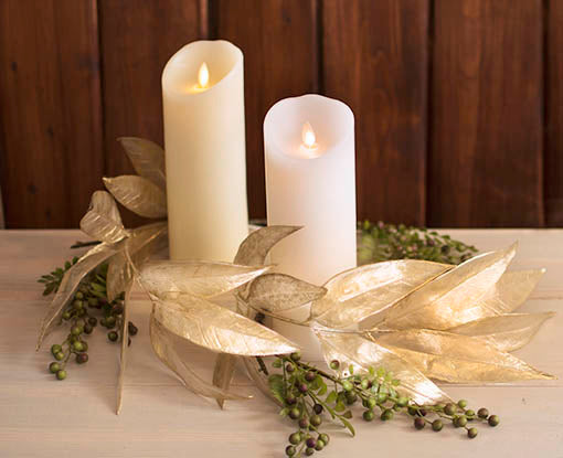 Luminara candles lend a classic glow to any centerpiece, whether at a large scale event or in your well-appointed home. Pictured with our high quality faux foliage, sold separately.