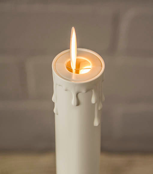 The faux flame rests on an electromagnetic coil and