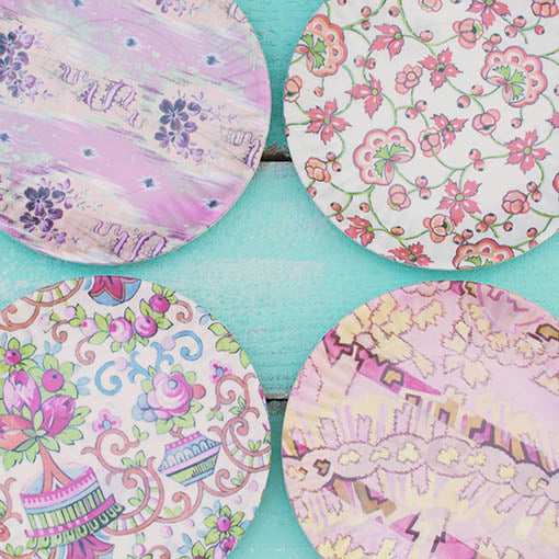 Vintage Parisian prints and patterns grace each melamine plate, lending your table a uniquely vivid vibe.