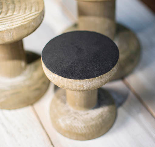 Each wooden stand is felted on the bottom to protect your table surfaces and to prevent tumbling.