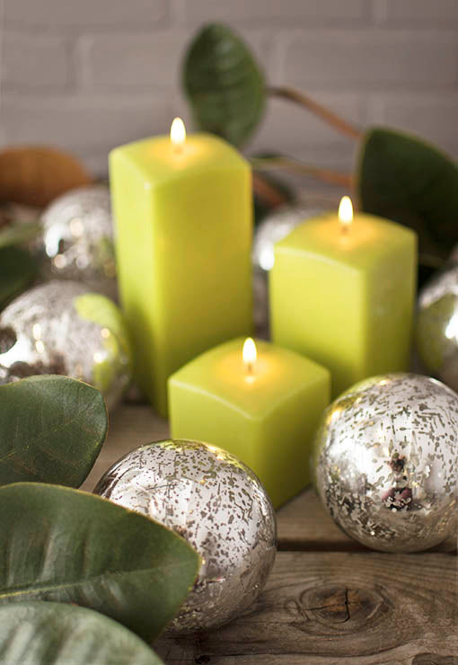 Add our magnolia branch and green square pillar candles to these mercury glass orbs for a garden fresh centerpiece.