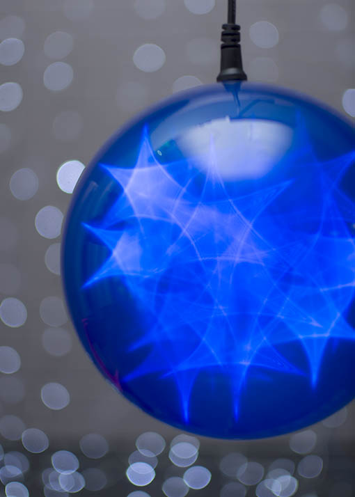 Gaze into the dreamy blue sphere as it twinkles and glimmers through any of four distinct settings.