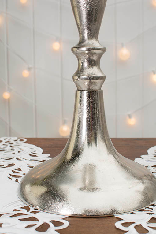 The distressed silver finish gives this compote a rustic antique style that pair perfectly with our lace table runners and other distressed silver decor.