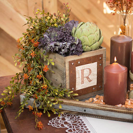 Mix our faux floral with our wooden planter boxes, wooden trays and metal ribbon as a country chic centerpiece