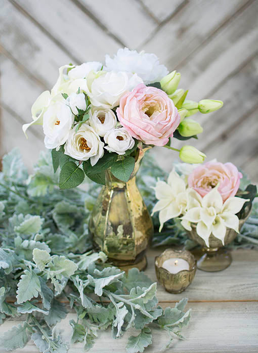 Embellish your tables with our dusty miller surrounded by gold mercury glass and our decorative floral!
