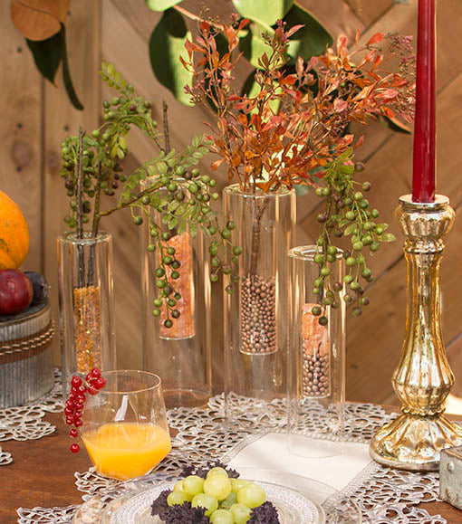 Show off our leaf sprig's natural details with our mercury glass candle holders and vintage table runners.
