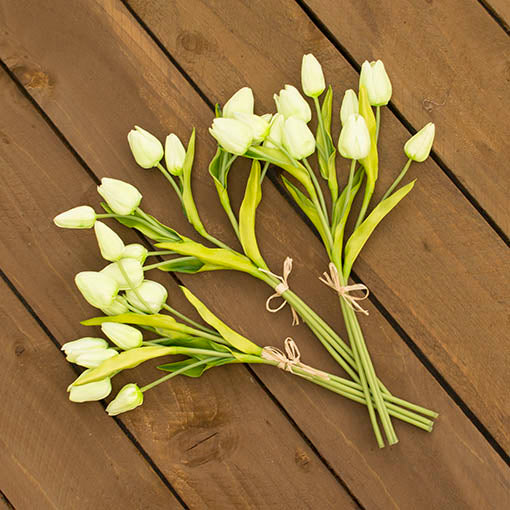 Each bouquet comes with 3 stems, each stem consisting of 3 tulip buds. Place these blooms in a green corrugated vase with sprigs and sprays for a lush garden centerpiece.
