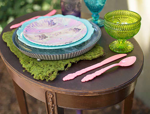 Assemble the finest cast of characters for your garden party: moss, vibrant plates, colored glass and fashionable flatware set the scene. All items sold separately.