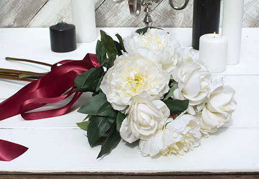 Add our white rose buds and red ribbon for a twist on traditional Christmas.