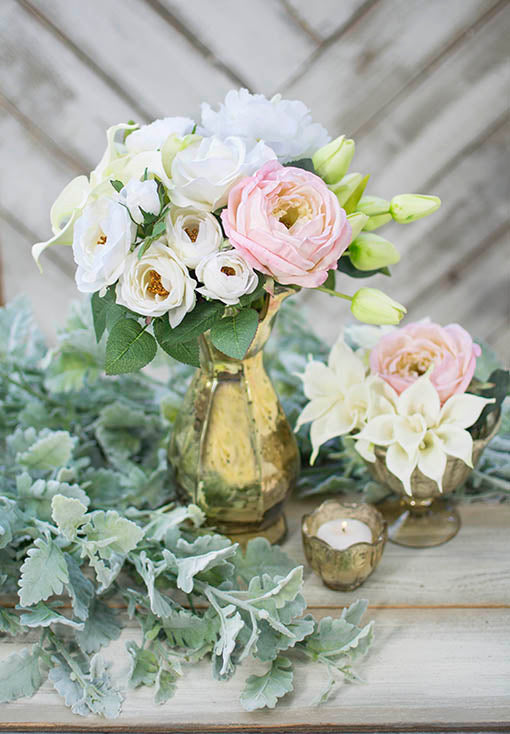 Create romantic tablescapes for your wedding by combining our decorative ranunculus stems with our gold mercury glass, realistic dusty miller, pink and white roses, and miniature calla lily blooms.