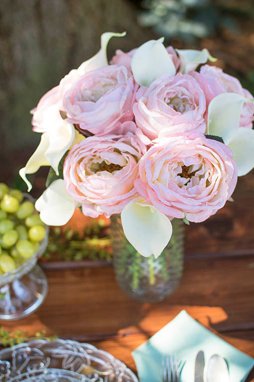 Use a clear glass hobnail vase to accent the vintage colors of our realistic pink roses and calla lilies!