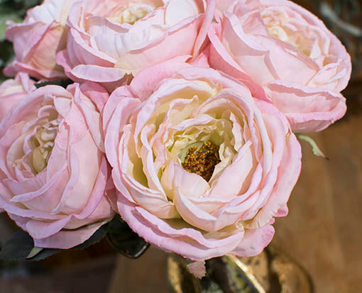 Each decorative rose bloom is accented with lifelike details that resemble actual roses.