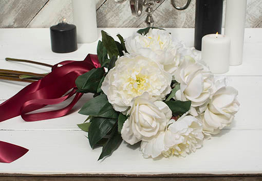 Pair these blooms with our white peonies and red ribbon for an elegant addition to Christmas decor.