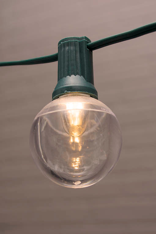 Globe String Lights, 1.5 in. LEDs, 25 ft. Green Wire, C7, Warm White