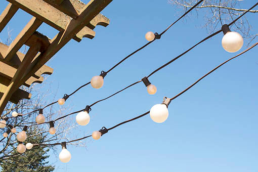 50 foot long Brown Wire Duet Globe String Lights, Pearl White Bulbs, 2 inch and 1.25 inch diameter incandescent