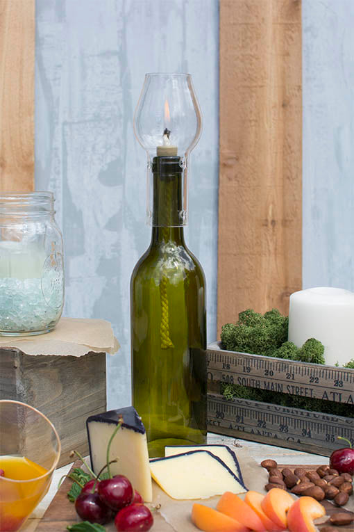 Pair our hurricane bottle lamp with mason jars and a yardstick ruler crate for a rustic influence table setting!