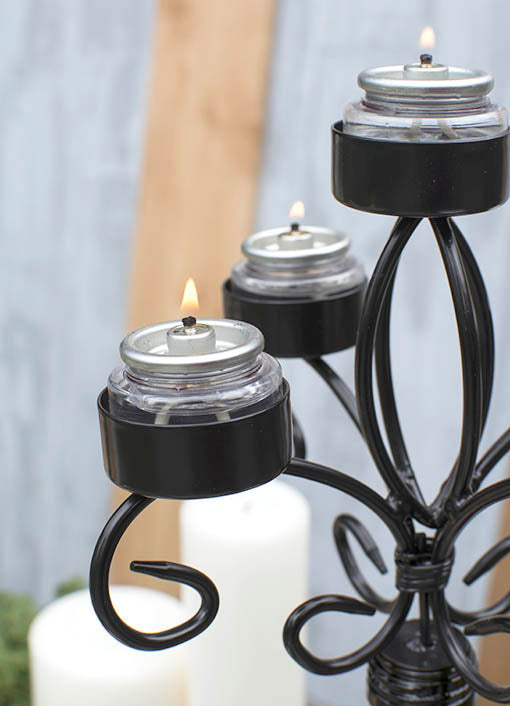 Looking to try something a bit different? Replace the wax tea light candles with liquid paraffin tea light candles. We love how they add an industrial edge to the candelabra!