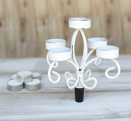Each candelabra comes with 5 tea light candles (replaceable).