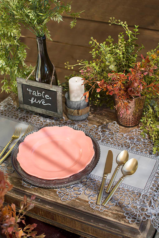 Melamine and glass table ware make a dramatic juxtaposition over this darkly beautiful vintage style lace. Pictured with tin and mercury glass decor, sold separately.