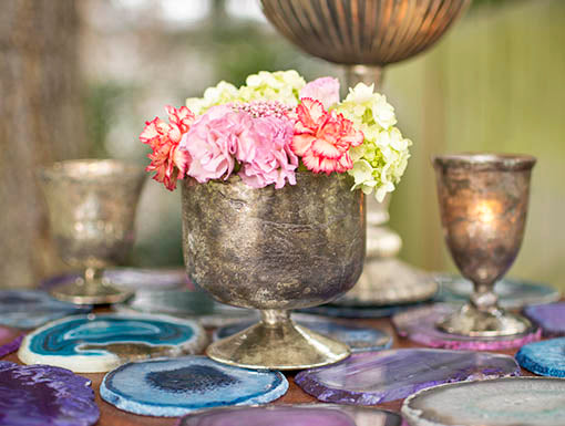 Add even more character to this distinctive compote: detail with fresh or permanent flowers and pair with glowing votive candles in sister candleholders. All items sold separately.
