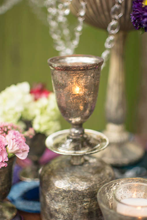 Set a table full of charm arranging--even stacking--our weathered, Roman glass styled compotes and candleholders. Contain glowing votives, fresh or faux florals, or table numbers with style.