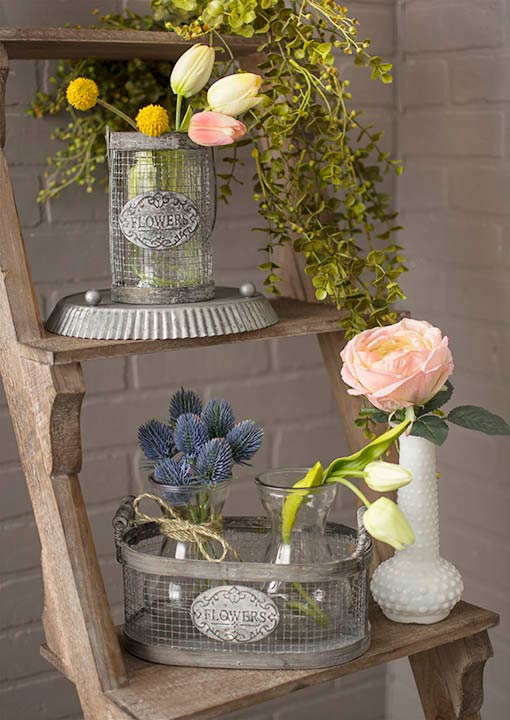 Garden displays enrich spring weddings with the soft details of realistic tulips, thistle and roses alongside the weathered accents of our metal wire baskets. Finish this look with a milk glass vase, a rustic tart pan and our decorative garlands.