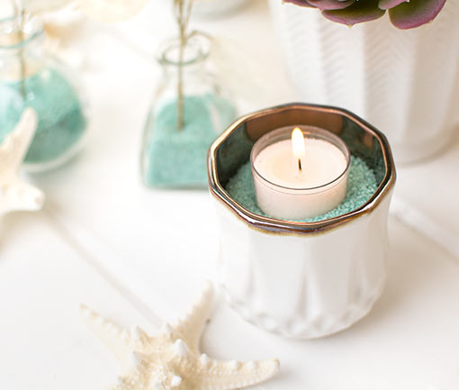 Fill a faceted candle holder with this blue sand and add a tea light candle for your wedding centerpieces.